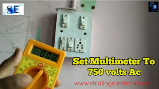 multimeter set to 750 volts ac