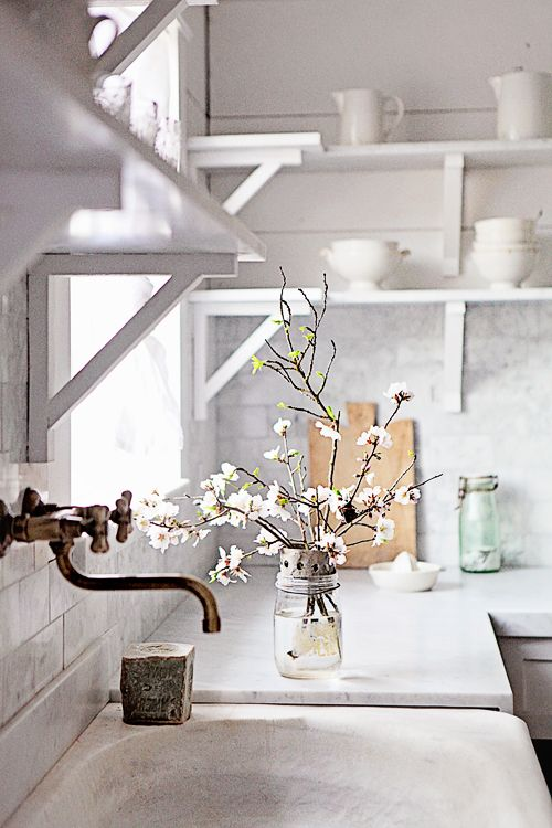 White French farmhouse kitchen with stone sink, open shelving and marble by Dreamywhites