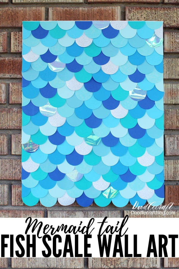 The different shades of blues, the glitter paper and the iridescent shimmer make this mermaid scale wall art the perfect home decor or party decoration.