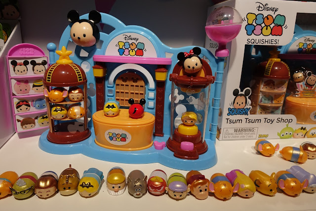 A long line of Tsum Tsum in front of a plastic shop