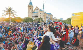 Protesters at Karachi's Frere Hall during Aurat March 2021