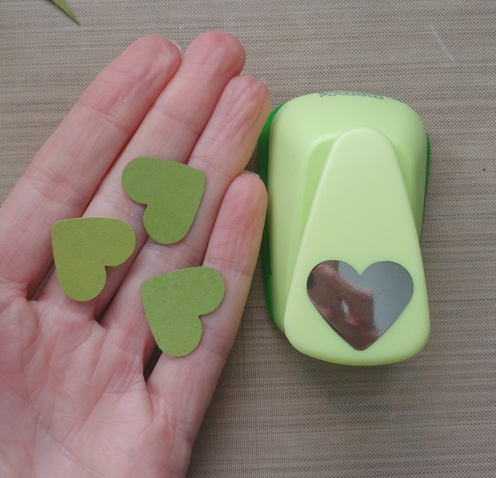 make a paper clover with hearts