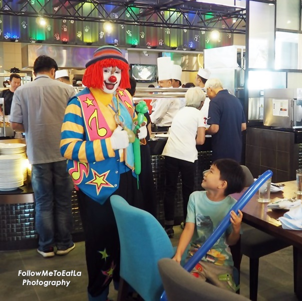 Young Ones Are Kept Entertainment With Clown