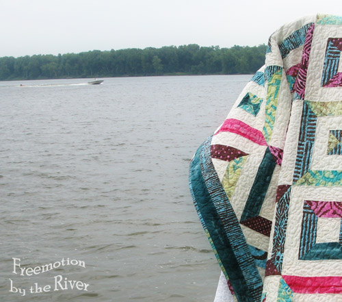 Skier on the river beside a quilt