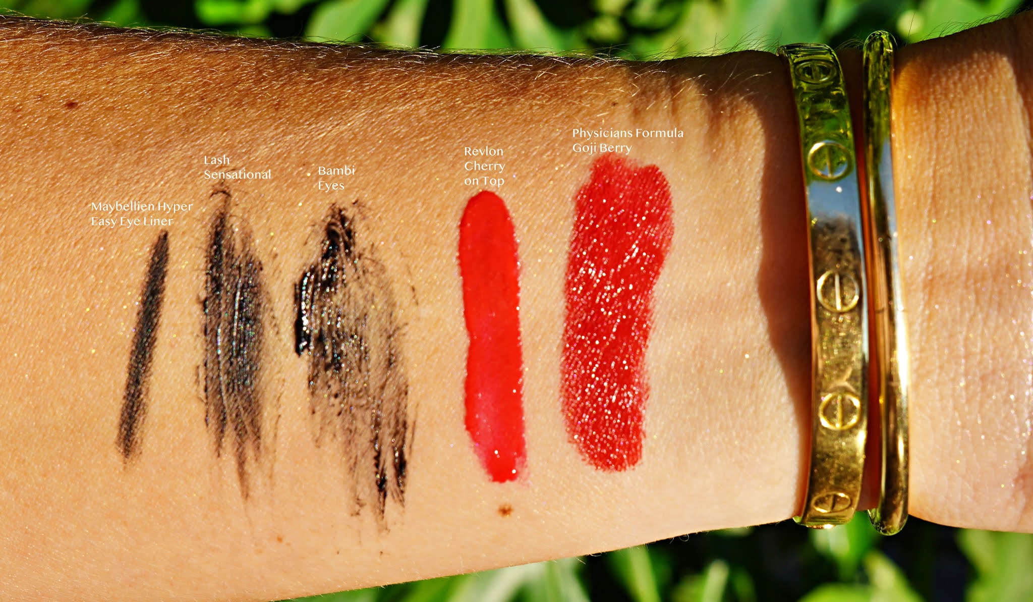 eye and lips makeup swatches on an arm