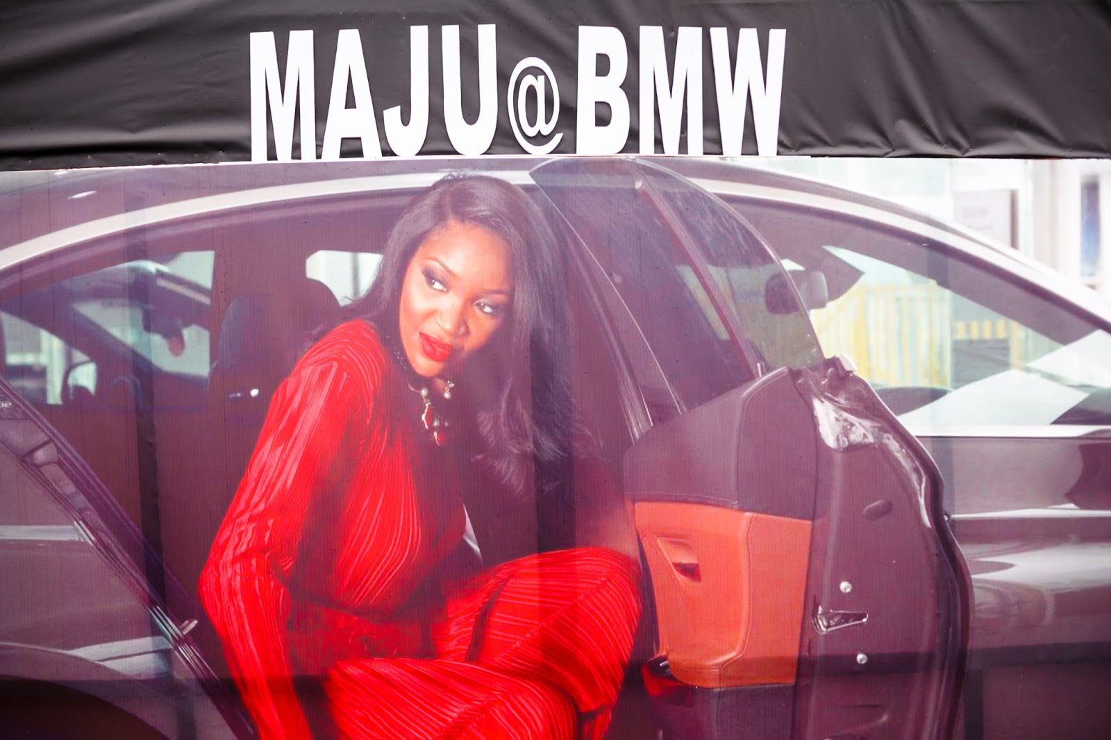 maju+bmw banner at eko atlantic shopping party lagos nigeria