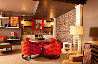 Cozy Red Upholstered Dining Chairs around the Rounded Table under a Glass Lamp above Brown Carpet