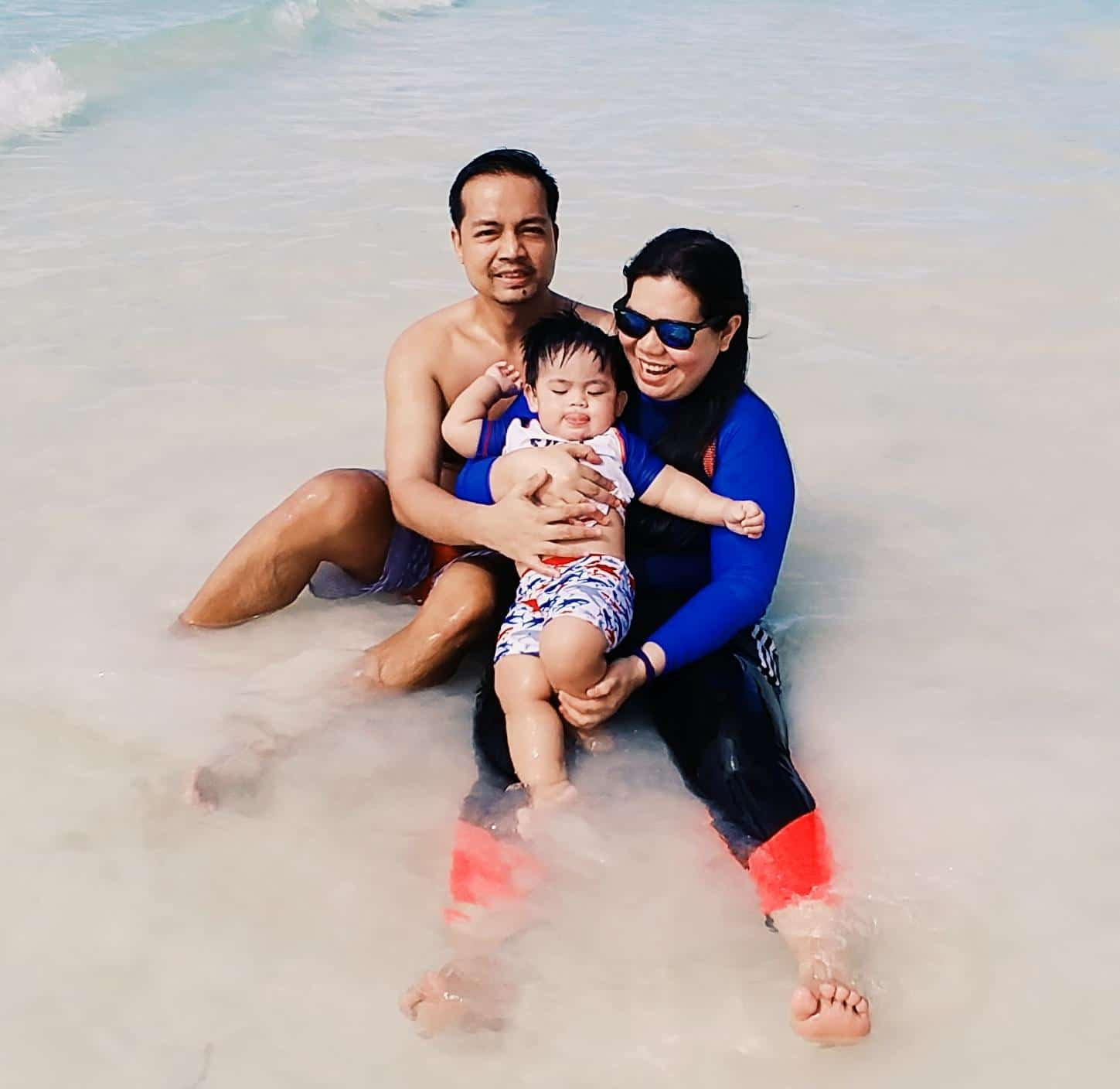 Swimming with a baby on the beach
