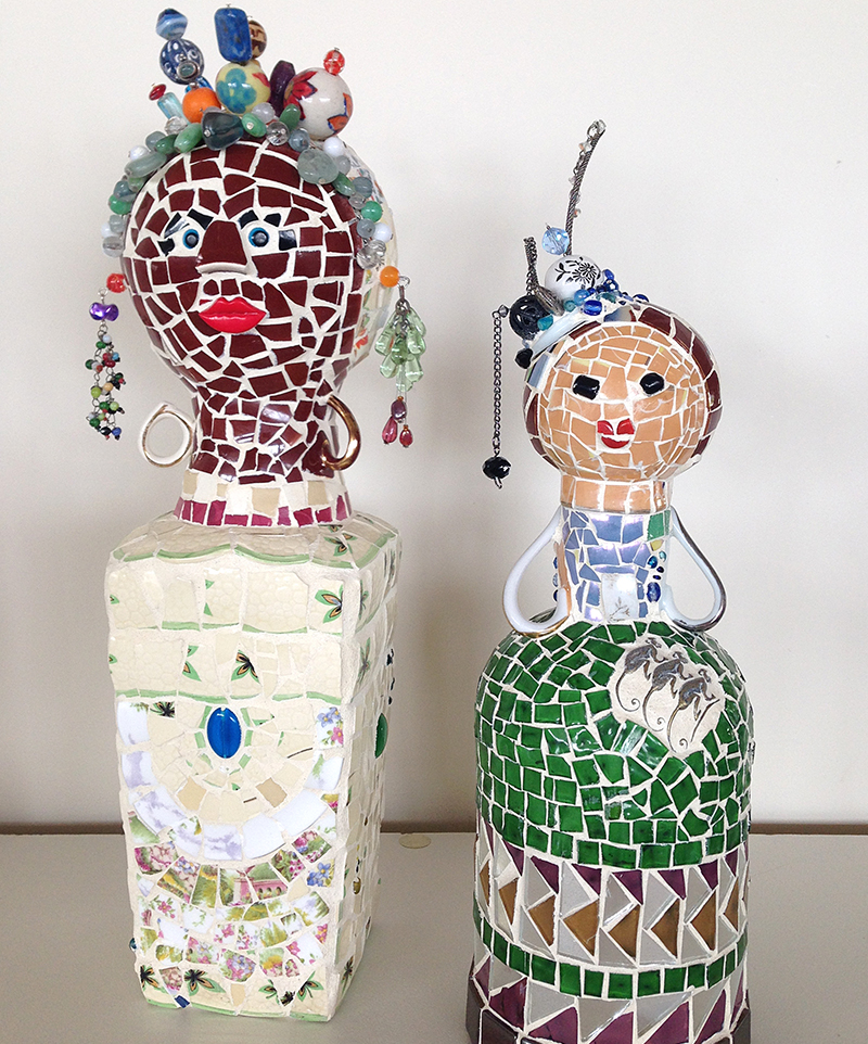 Colourful mosaic ladies, sculptures