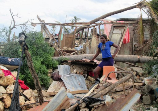 The first major handout of food aid took place along Haiti's storm-wrecked southwest coast on Wednesday
