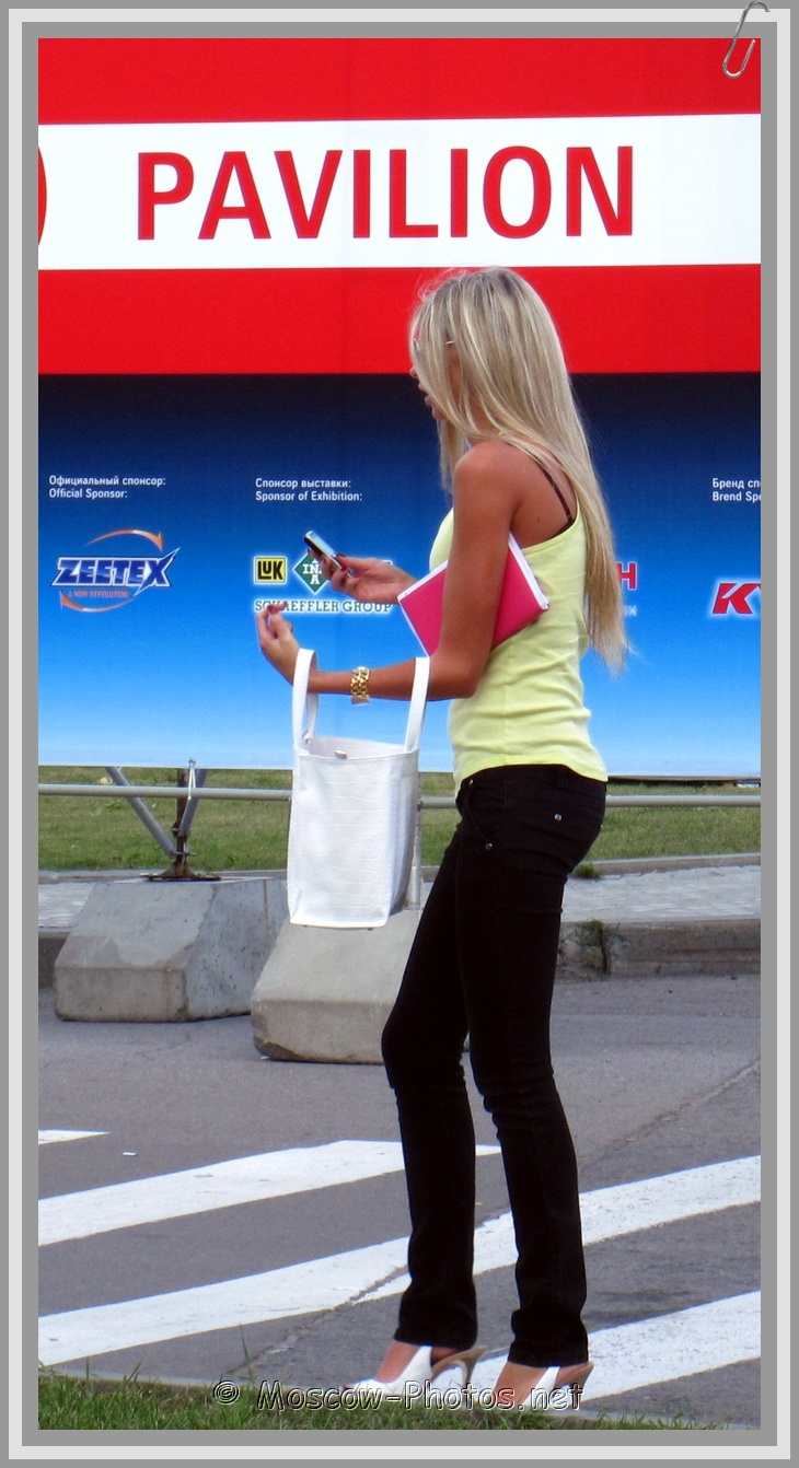 Slim Blonde Girl With White Bag