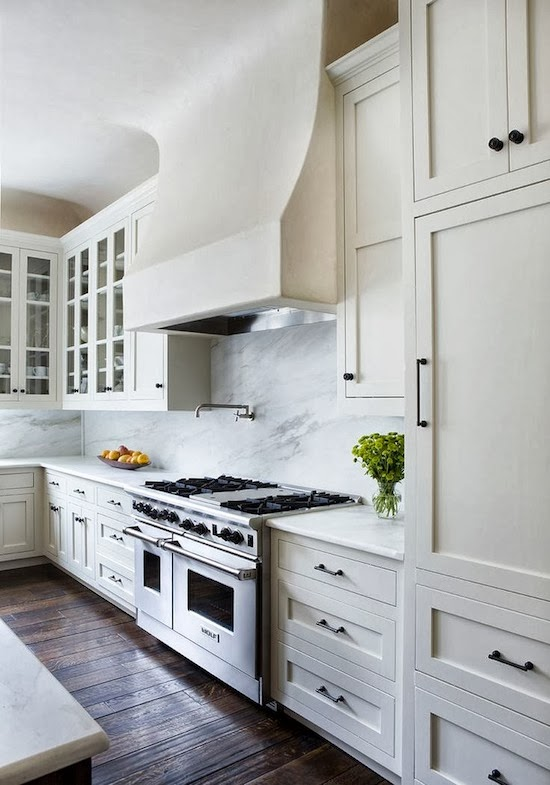 white kitchen, white massive stove hood, dark floors
