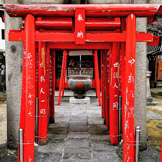 Red tori gates at a small shrine in Matsumoto Japan