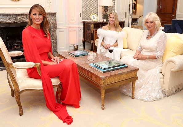 Melania Trump wore Givenchy Sequinned cape sleeve wool crepe gown. The Duchess wore a white lace dress, diamond necklace