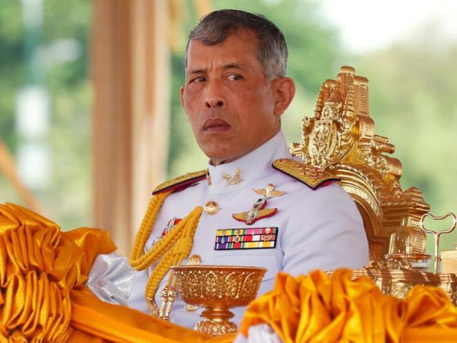 Thai king fires royal bedroom guards for 'adultery'