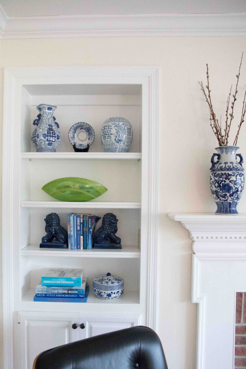 blue ginger jars in bookcases