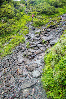Treacherous path starts descending along with flowing water