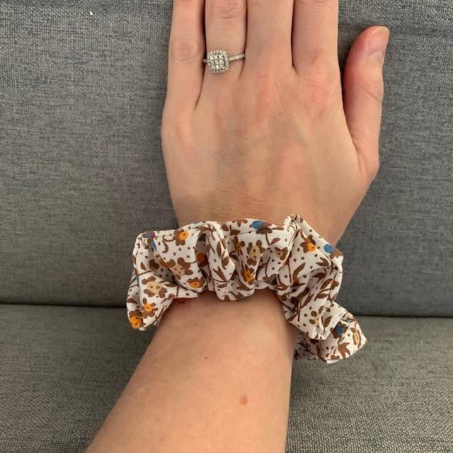 Brown and orange fabric hair scrunchie