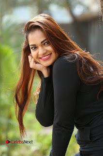 Actress Aswini Latest Stills in Black Denim Jeans  0036.JPG