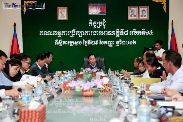 Officials attend a meeting earlier today at the Ministry of Labour in Phnom Penh where the new garment industry minimum wage was set at $153. Hong Menea