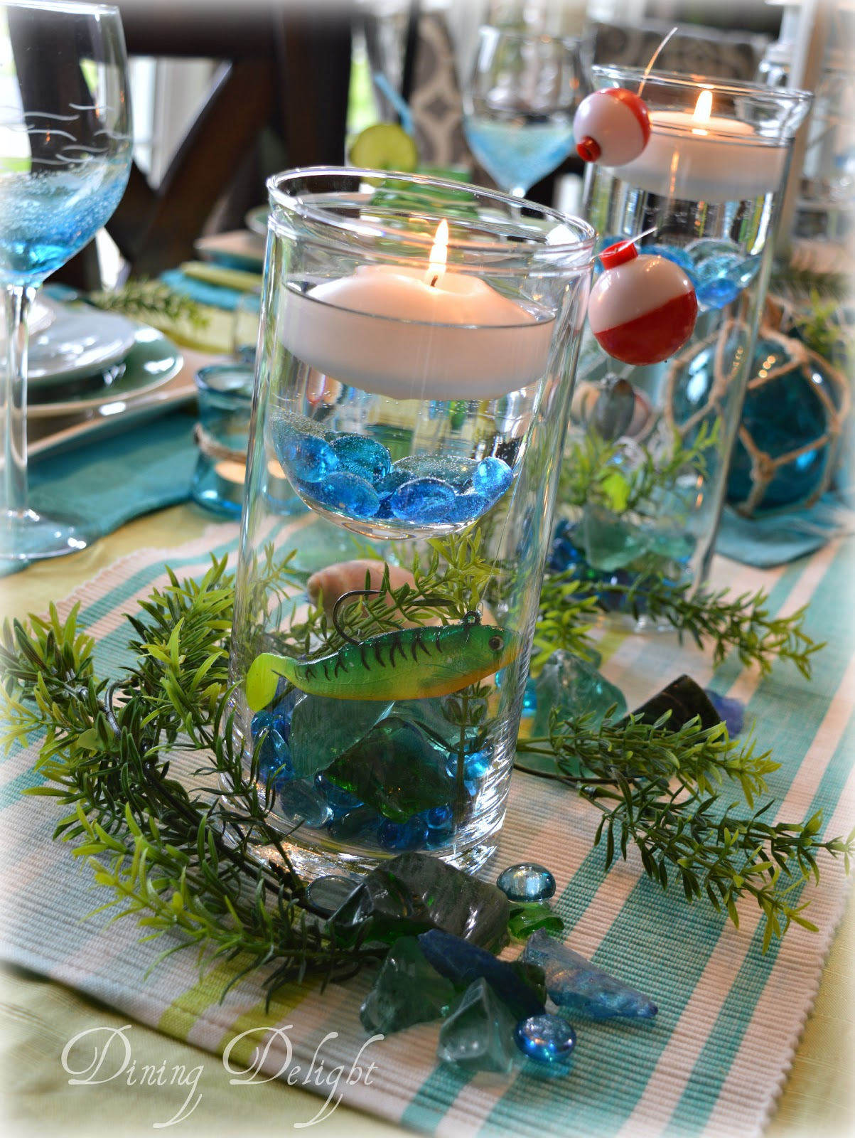 Dining delight fishing centerpiece in cylinder vase for Fish wedding centerpieces