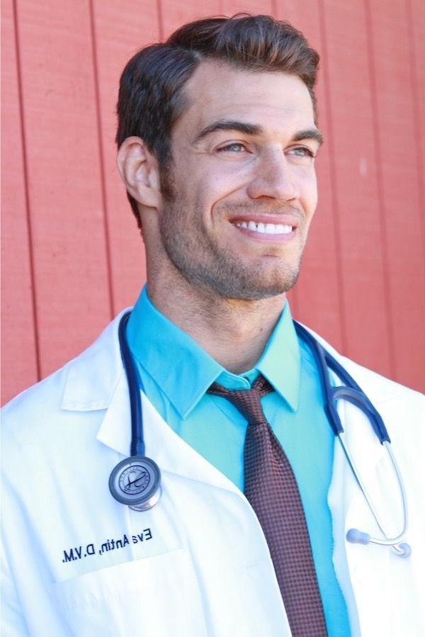handsome-male-doctor-white-uniform-smiling-stunner