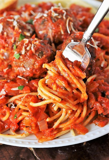 Twisting Fork into Spaghetti and Meatballs Image