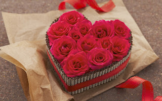 Bunch of red roses arranged in heart shape