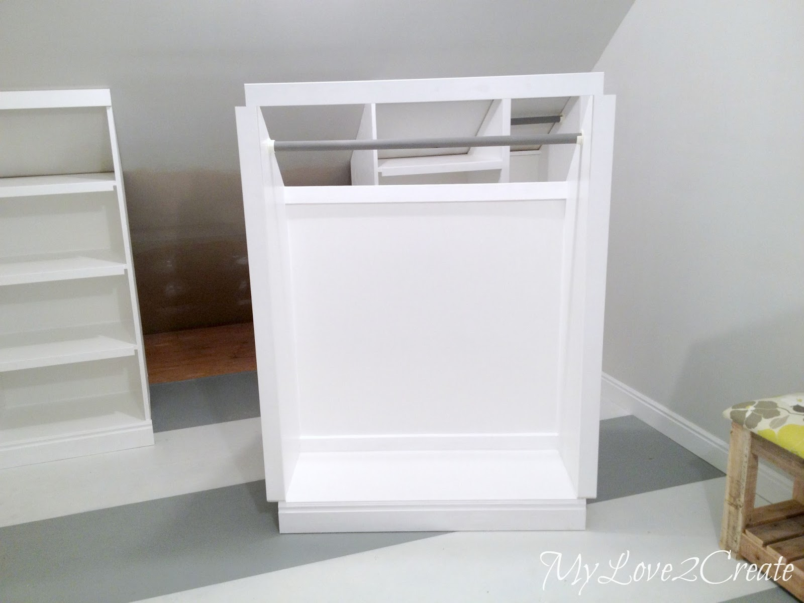 bedroom attic storage ideas - Slanted Wall built ins with Hidden Storage
