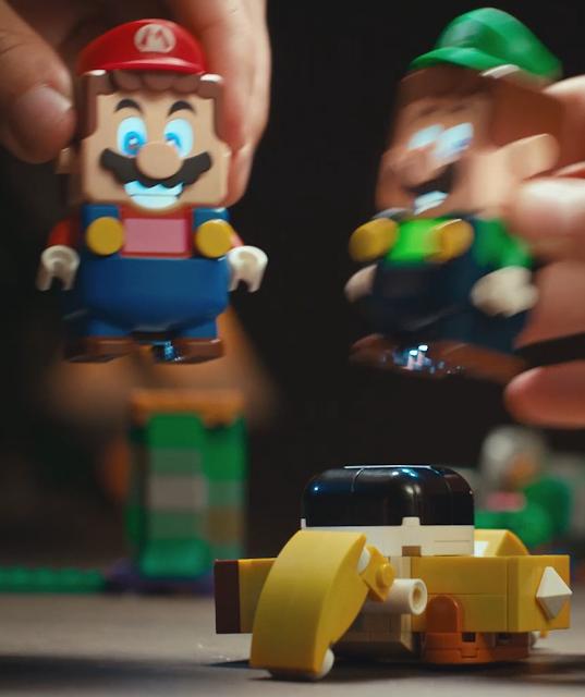 LEGO Super Mario Luigi jumping on Sumo Bro