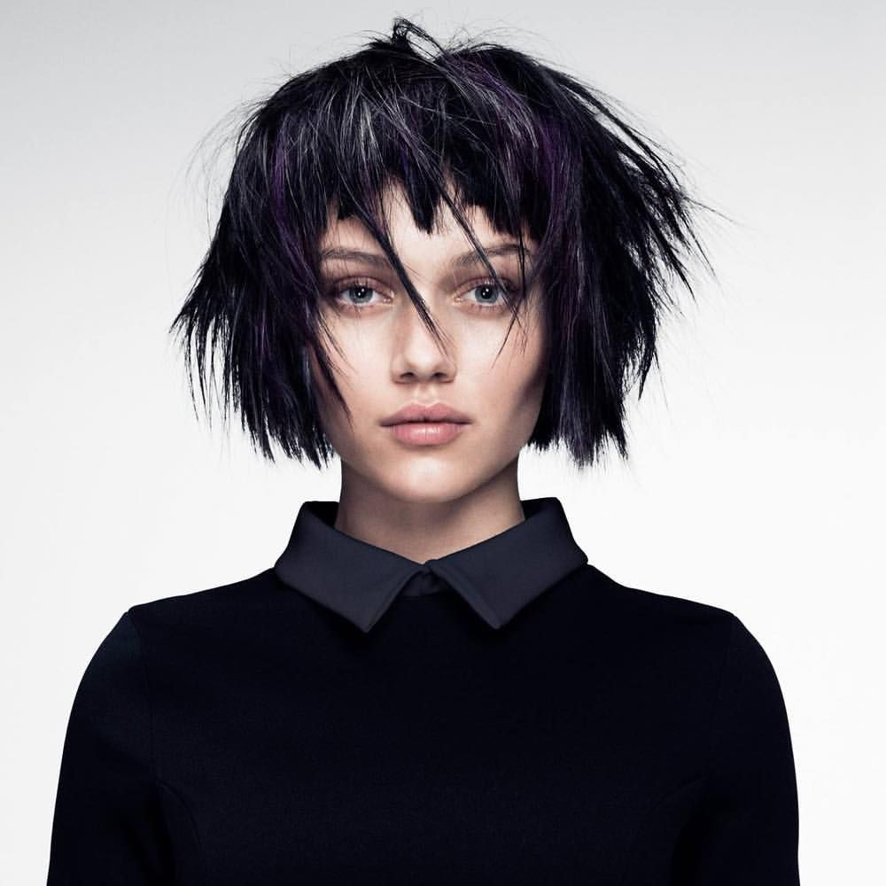a portrit of a woman with edgy shaggy bob haircut
