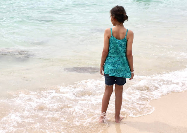 O+S pinwheel dress pattern as a camisole in teal voile, modeled on the beach at Cartagena, Colombia.