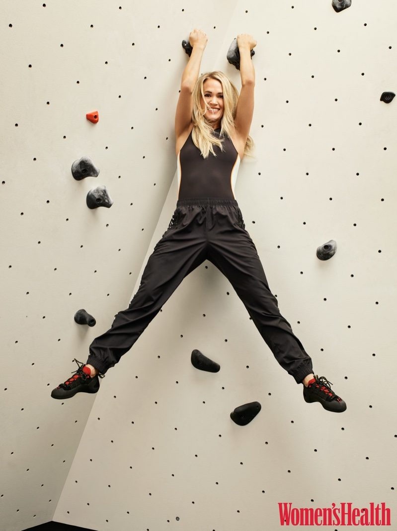 Carrie Underwood wears P.E Nation one-piece, Adam Selman Sport pants and La Sportiva climbing shoes
