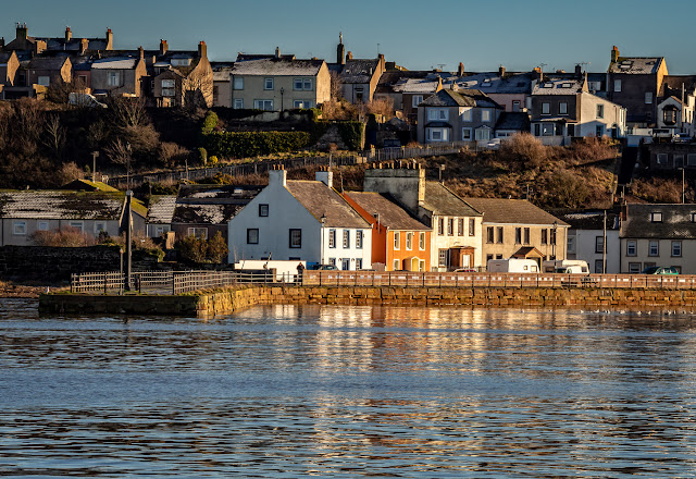Photo of cottages on North Quay, Maryport, reflected in the still water