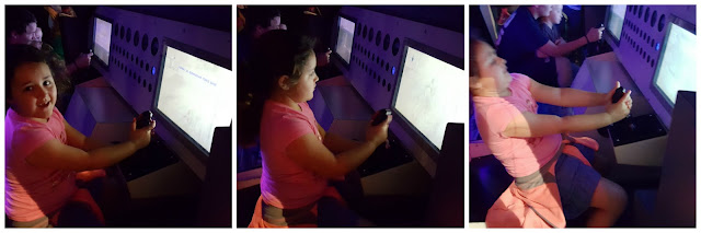 Maggie flying a simulator - Space Center Houston
