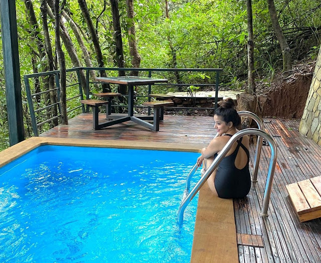 Monalisa looks enchanting in black monokini as she takes a dip in pool- newsdezire