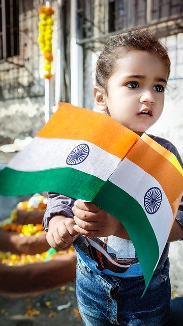 A cute Baby holding Indian Flag