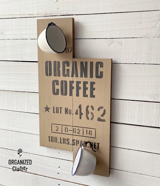 Photo of organic coffee sign with enamelware cups