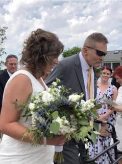 Phil walks his daughter, Jillian, down the aisle. Wendy Atkinson