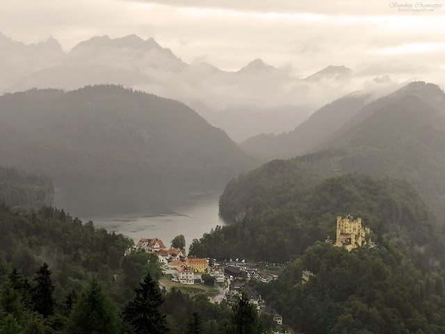 Hohenschwangau castle, Alpsee and the Bavarian alps as seen from the Neuschwanstein balcony.