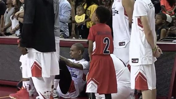 Chris Brown refuses to stand for national anthem during charity basketball game on 9/11 anniversary (photos)