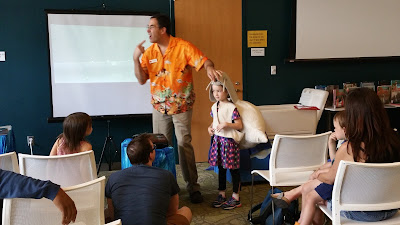 Tessa Barbero wears a snail costume to help Andrew Wilson explain about animals of the Chesapeake Bay