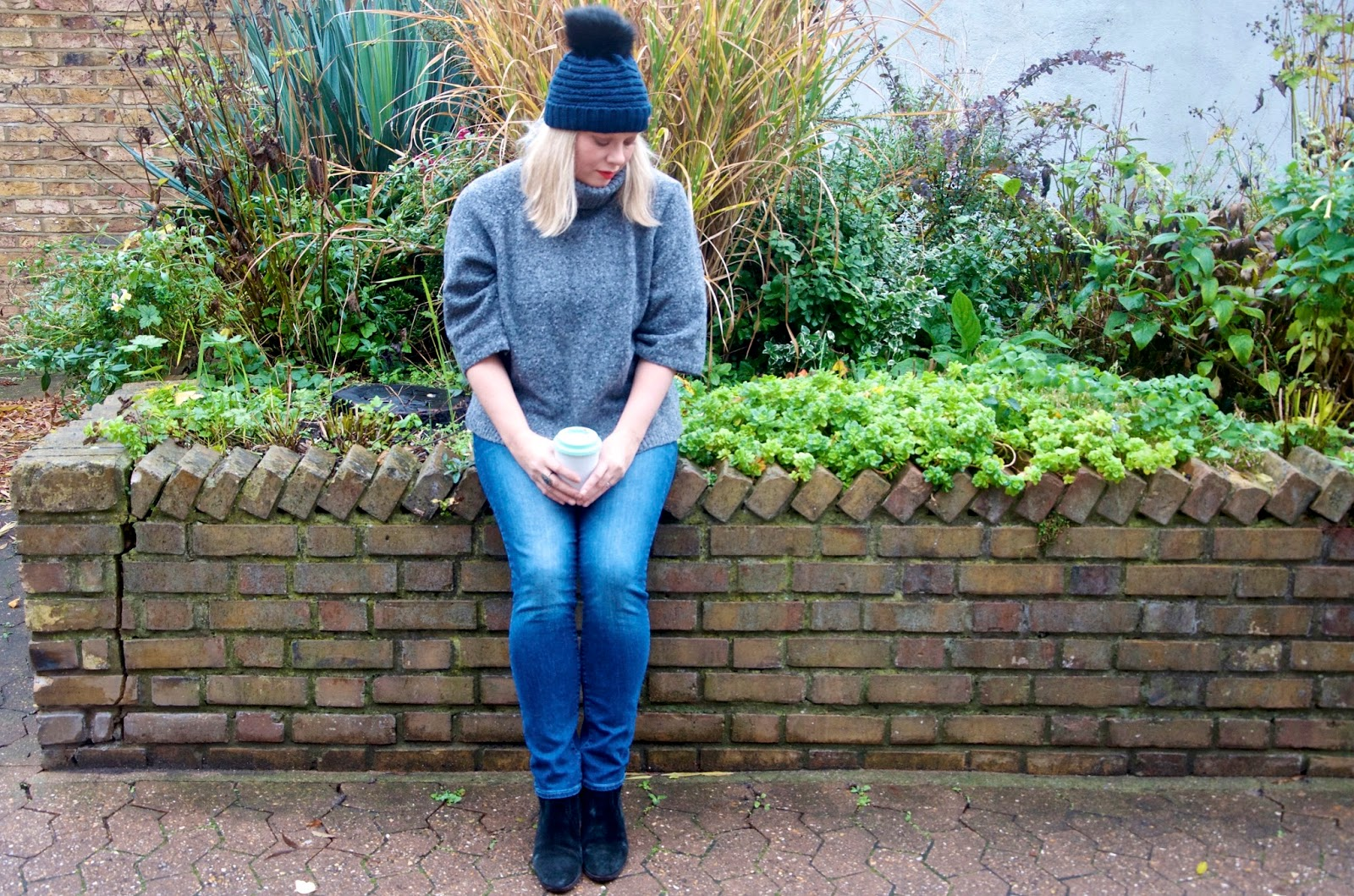 Bobble Hat, grey turtleneck sweater and jeans