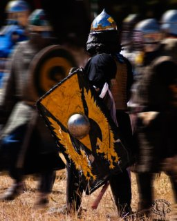 Professionally quality action photograph of heavy fighters in armor from the SCA in Mantua, Utah by Cramer Imaging