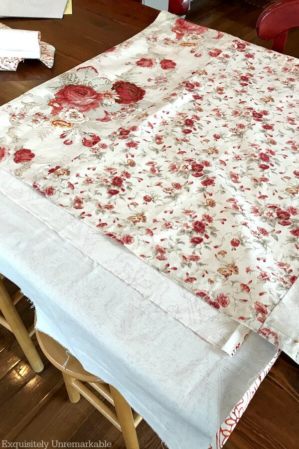 Red and white floral fabric to make a sink skirt.