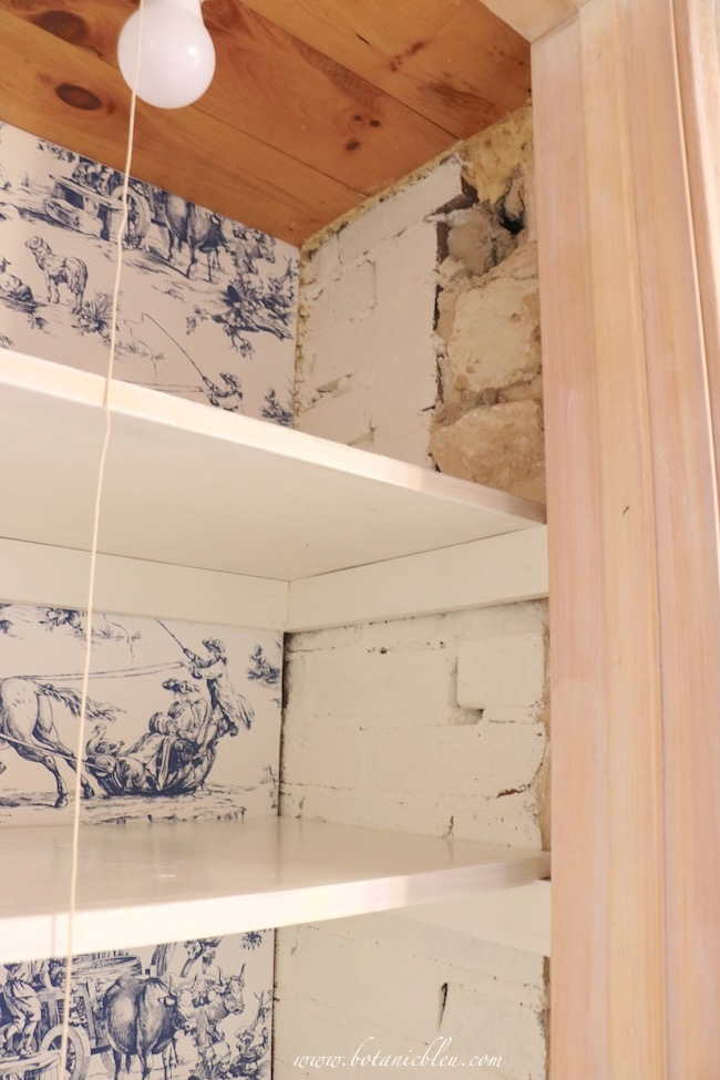 French Country Pantry Makeover with white painted brick wall