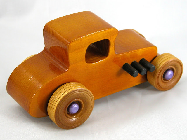 Top Right Rear -  Wooden Toy Car - Hot Rod Freaky Ford - 27 Coupe - Pine - Amber Shellac - Metallic Purple Hubs