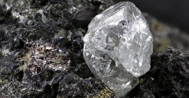 Diamond nestled in kimberlite, courtesy of Shutterstock.