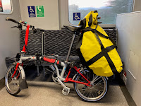 Overloaded Brompton on a train, heading into London