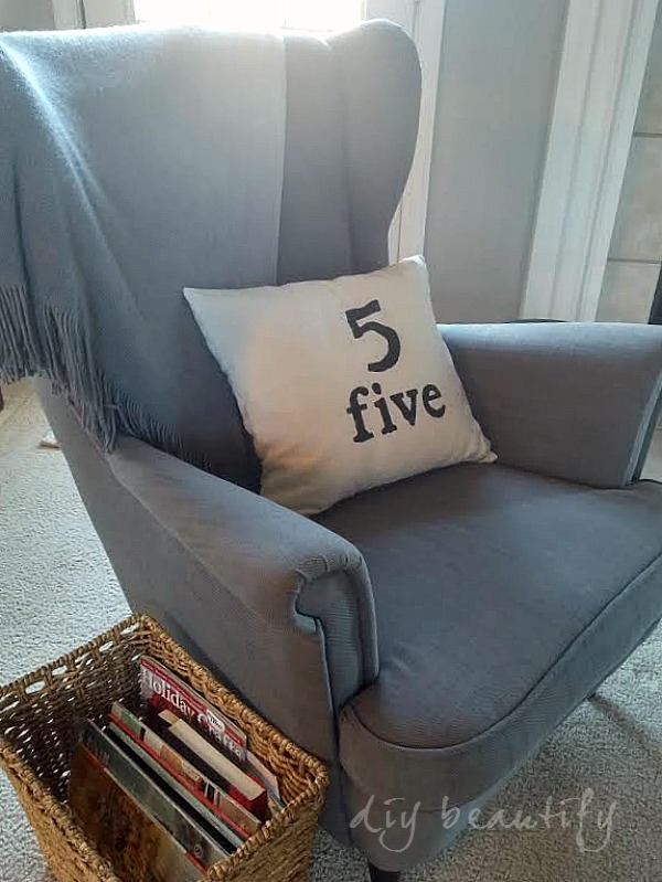 gray chair with drop cloth pillow